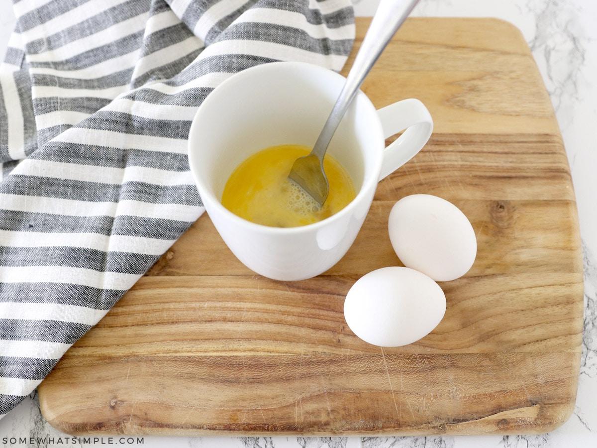 cracked eggs in a mug