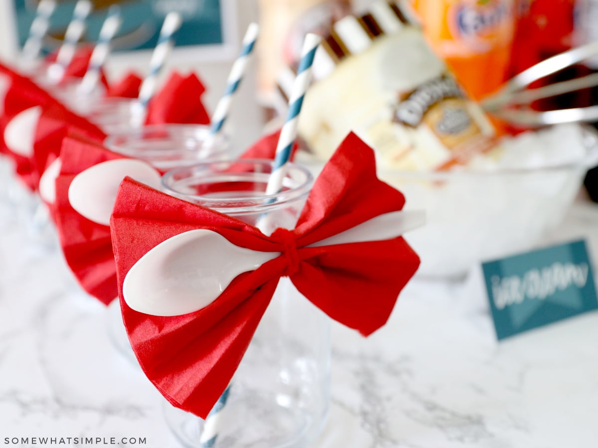 ice cream float cups with napkins and spoons