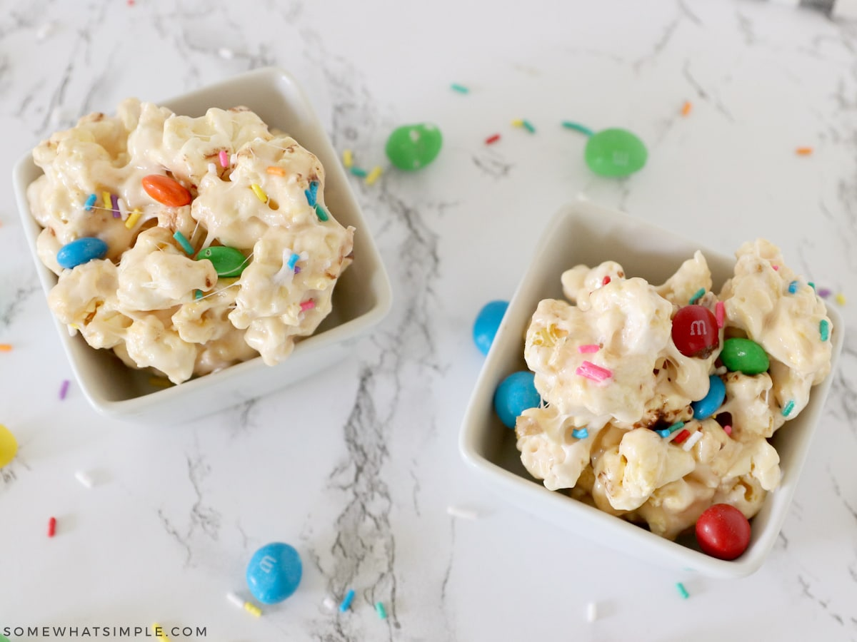 finished marshmallow popcorn in small white bowls