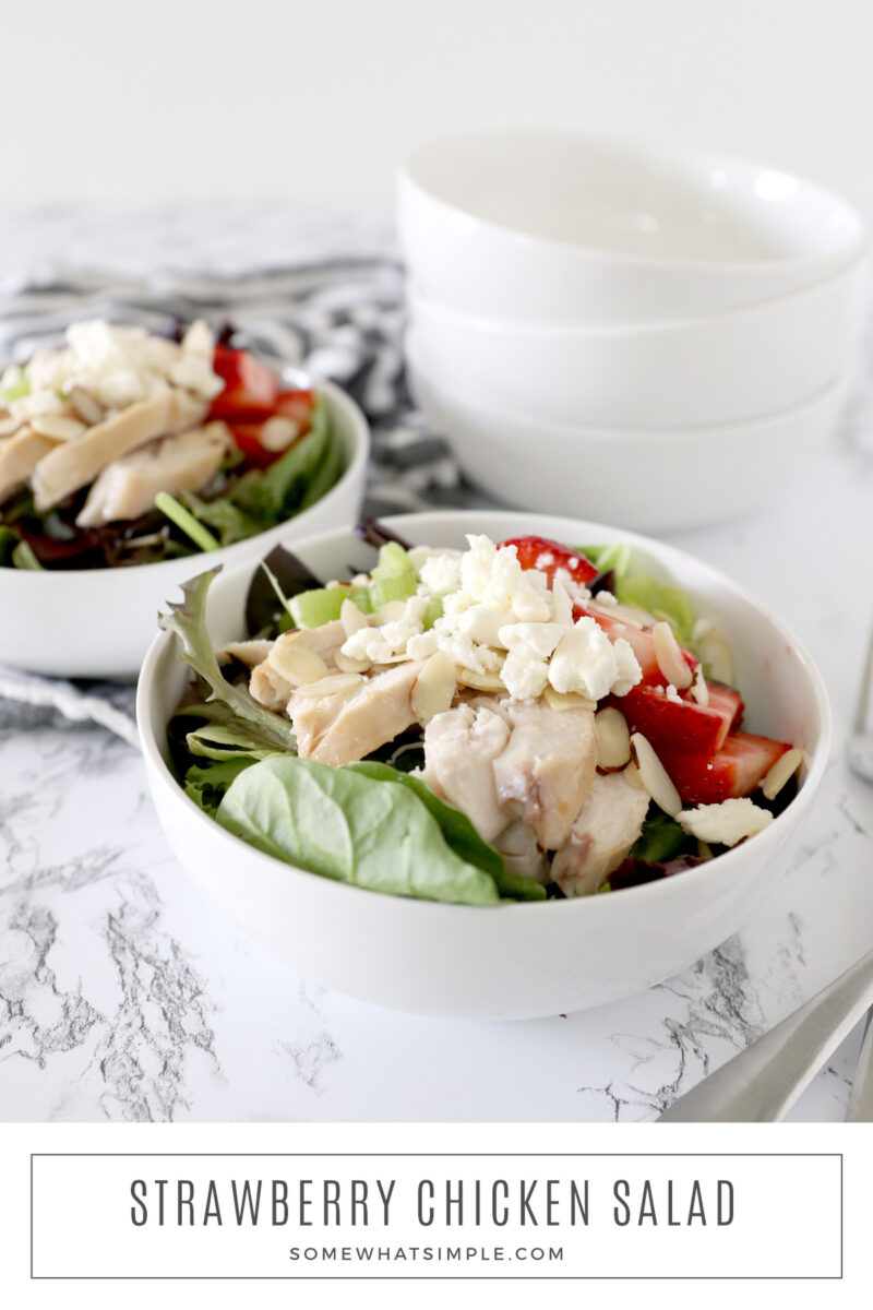 long image of two bowls filled with strawberry chicken salad