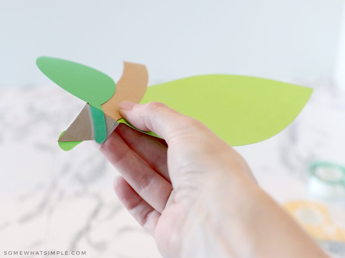 taping paper stems and leaves together