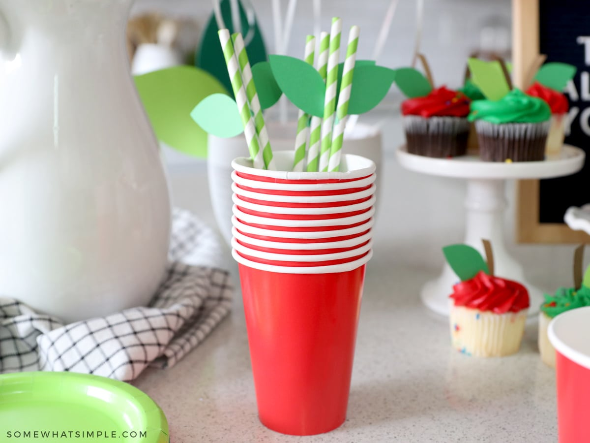 green paper leaves on green paper straws