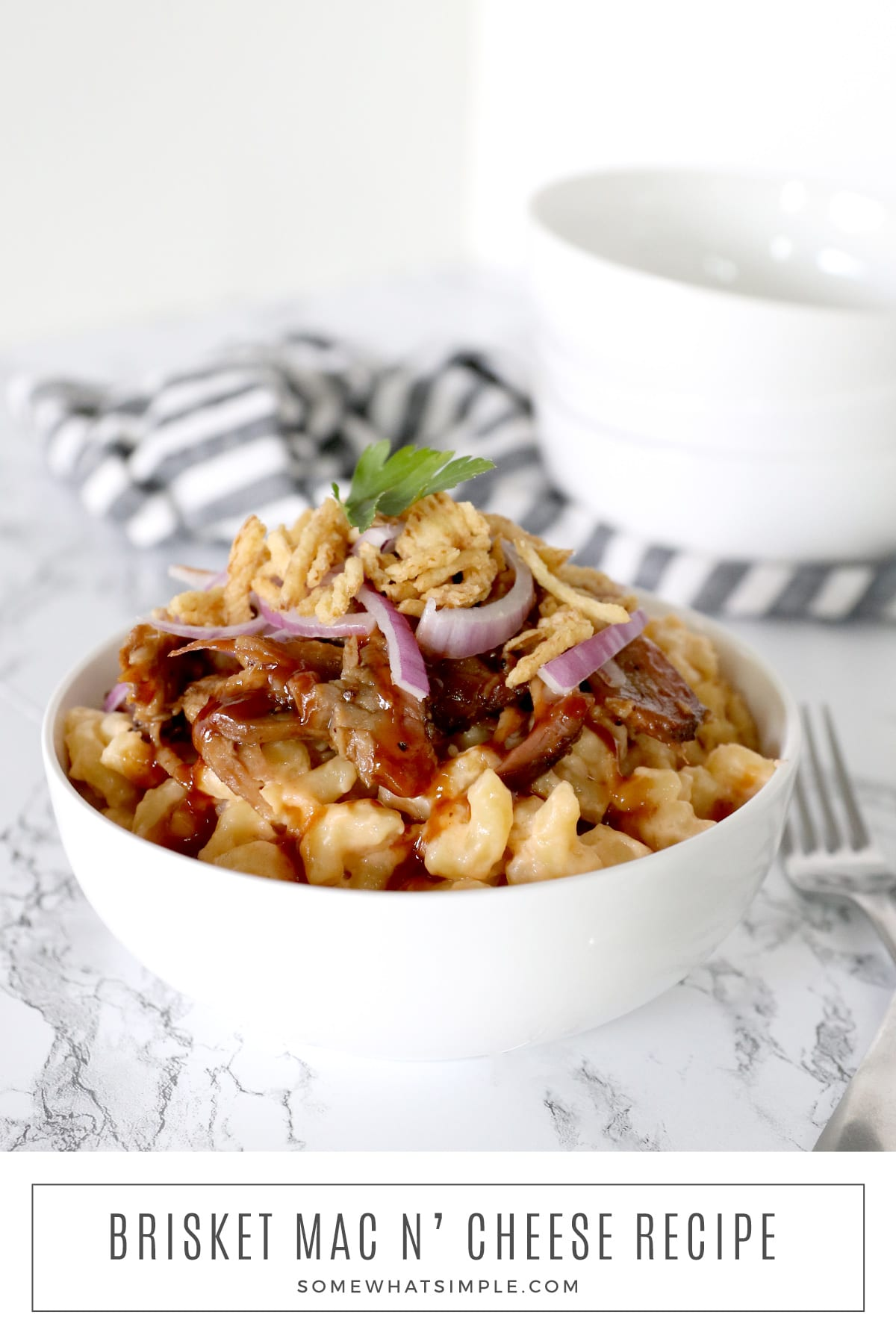 Creamy, cheesy macaroni topped with barbecue brisket, and crispy french fried onions - this Brisket Mac and Cheese recipe is a delicious crowd-pleaser! via @somewhatsimple
