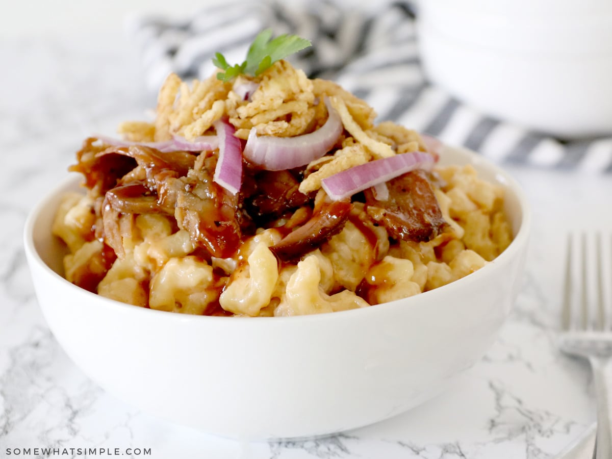 brisket mac and cheese in a white bowl
