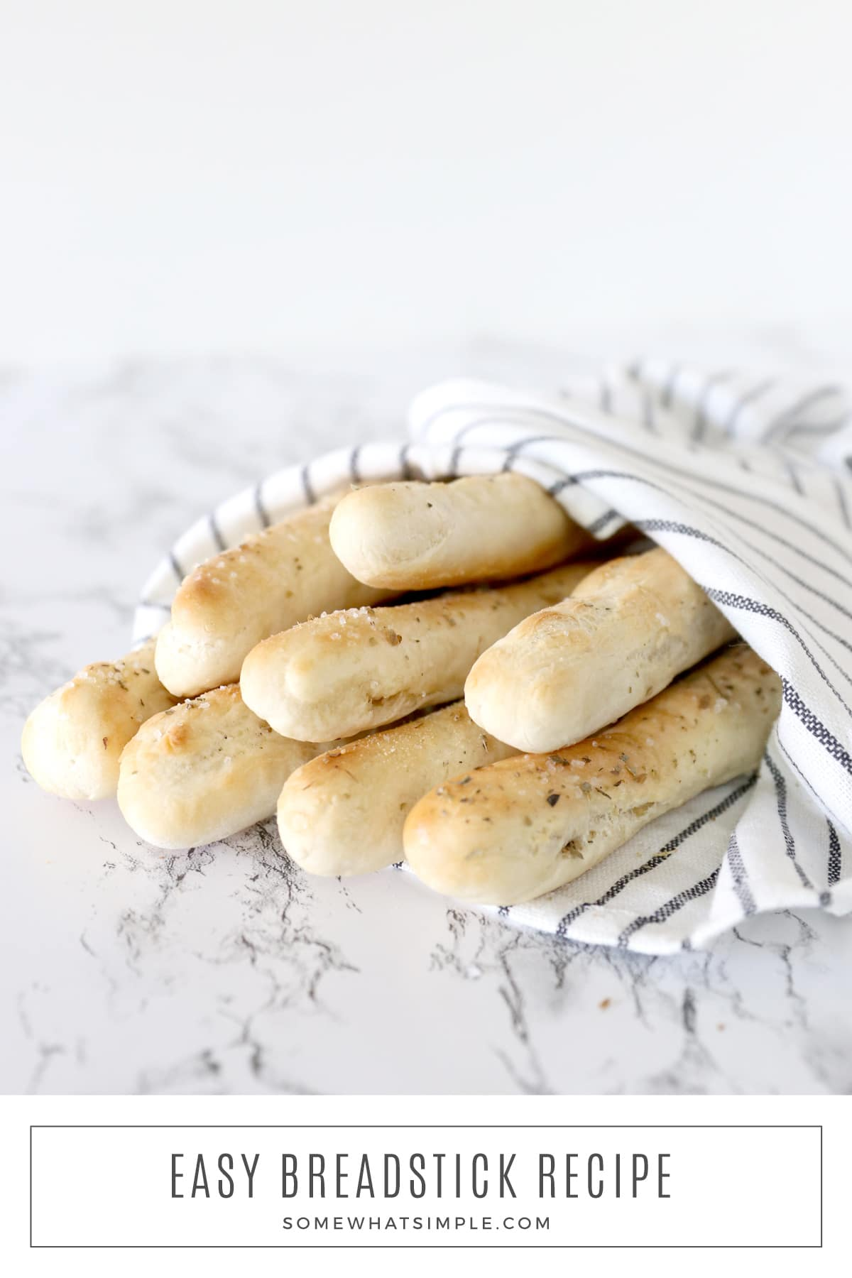Soft homemade breadsticks are made with just 5 ingredients and take less than 20 minutes to make! They're super simple and totally delicious! via @somewhatsimple