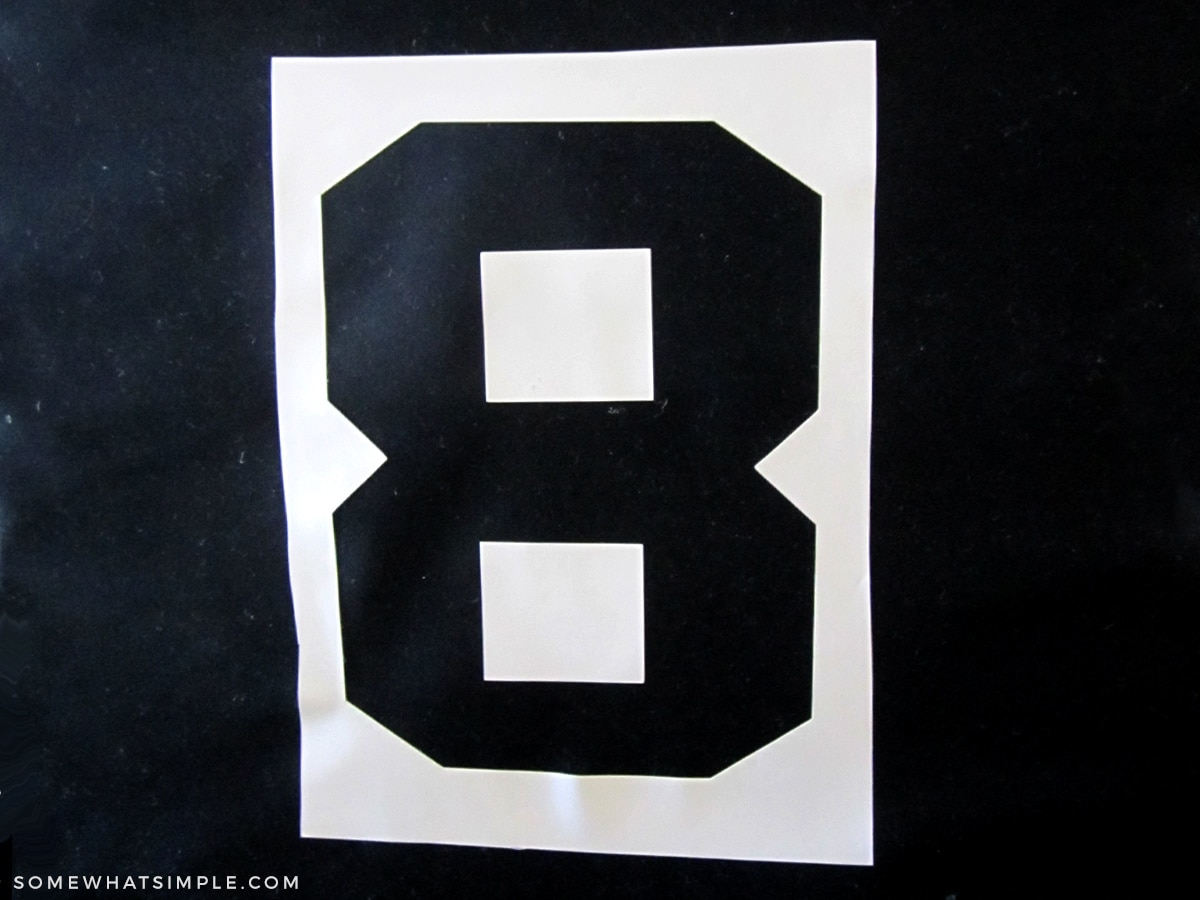 number 8 on a black fabric bin