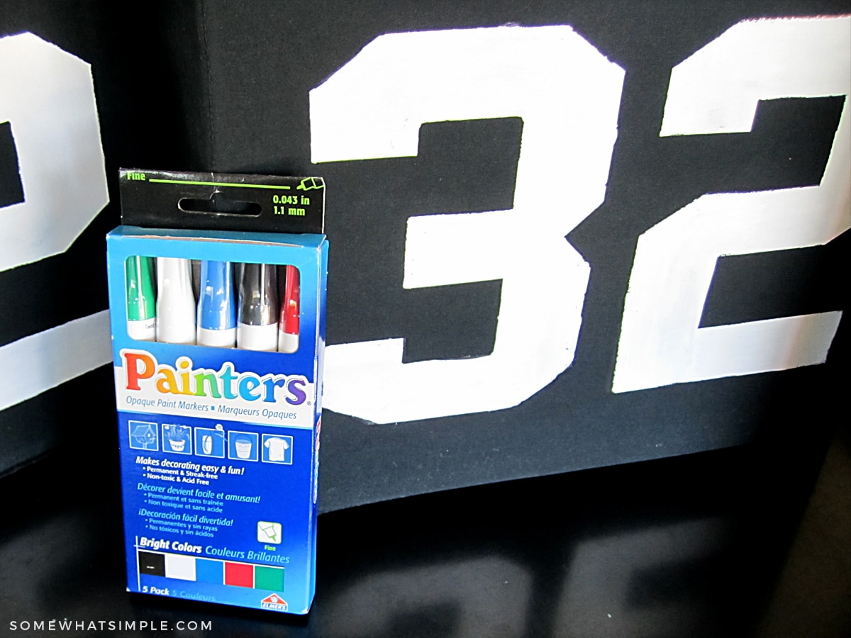 painters pens next to a black bin