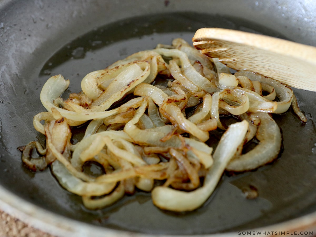 grilling onions for a pastrami sandwich