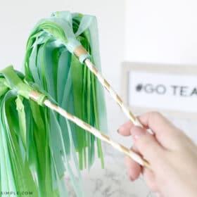 tissue paper pom poms attached to paper straws