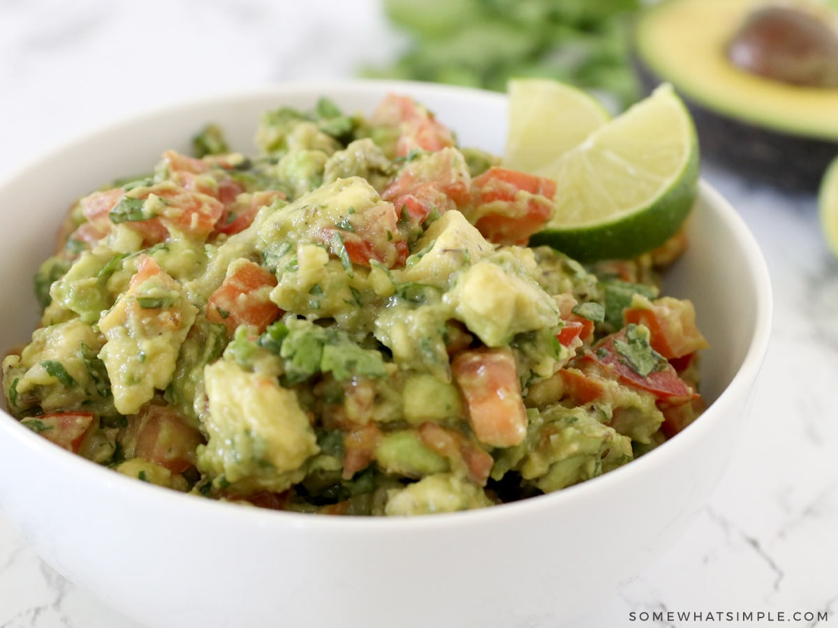 close up of a bowl filled with avocado salsa