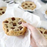 num num cookies being held in hand