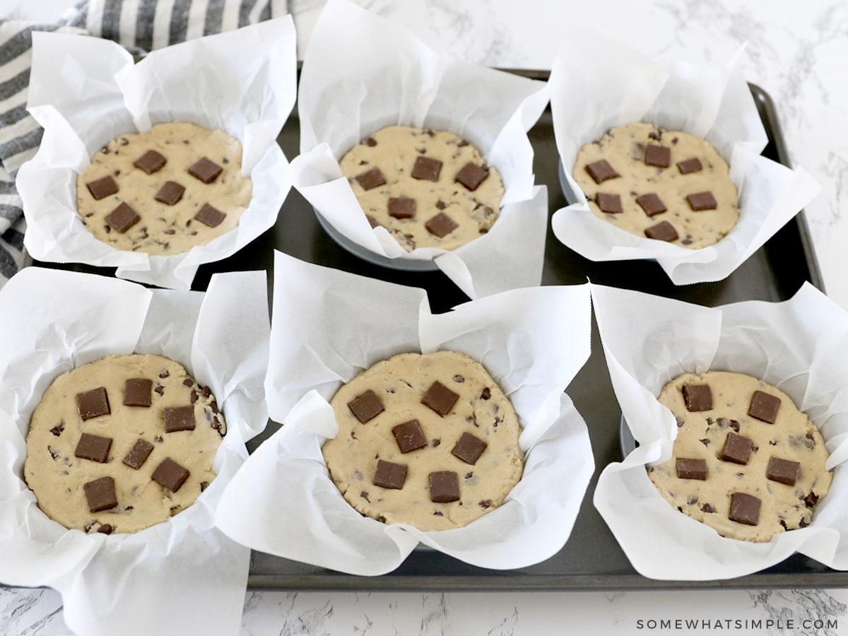 adding more chocolate chunks to cookie dough