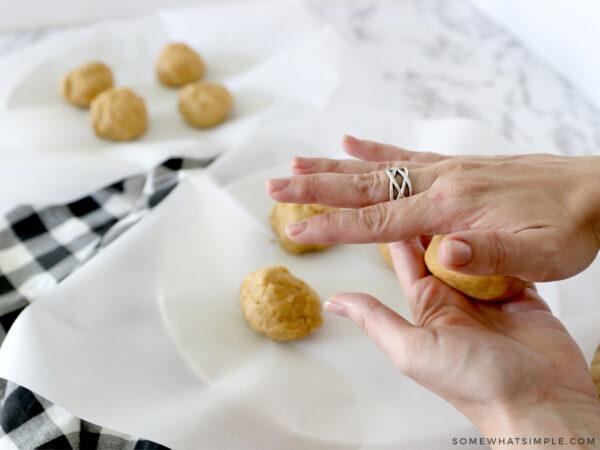 making balls of pumpkin sugar cookies