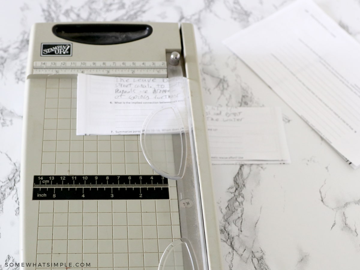 cutting paper with a paper cutter into smaller pieces