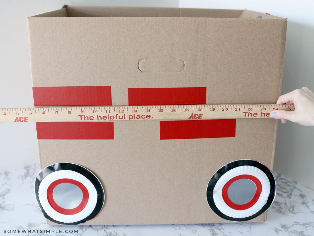 applying vinyl to a cardboard car