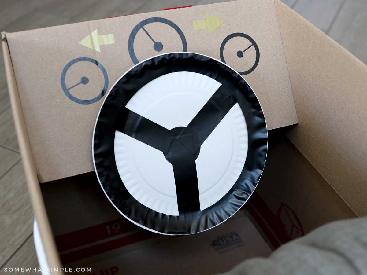 making a steering wheel from a paper plate and vinyl stickers