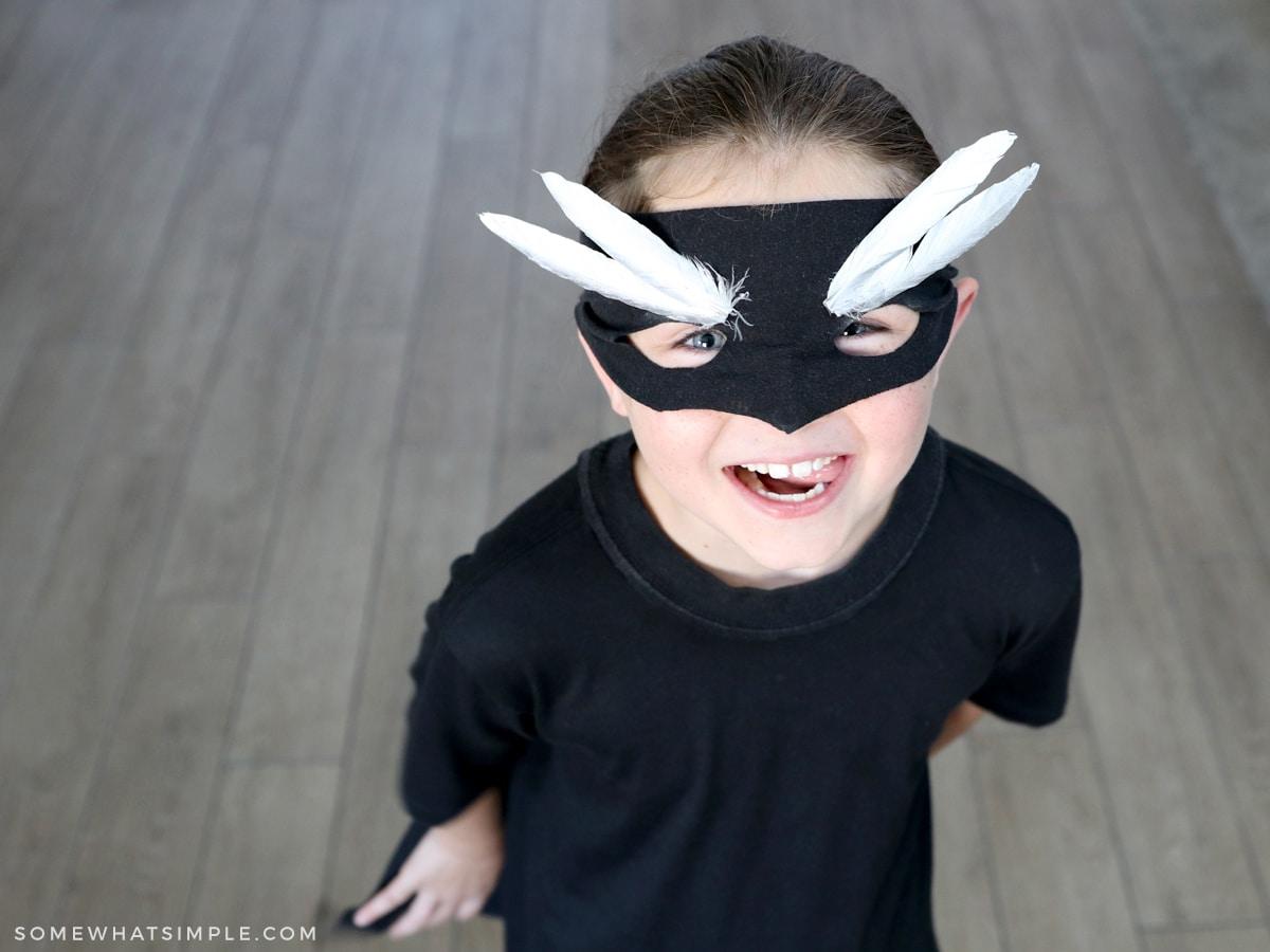childs superhero costume with black mask
