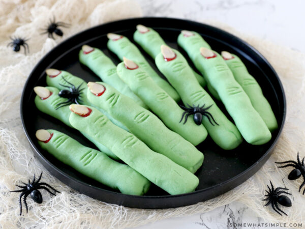 plate of green witch finger cookies