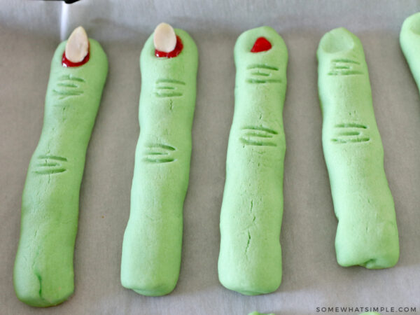adding red gel to witch finger cookies