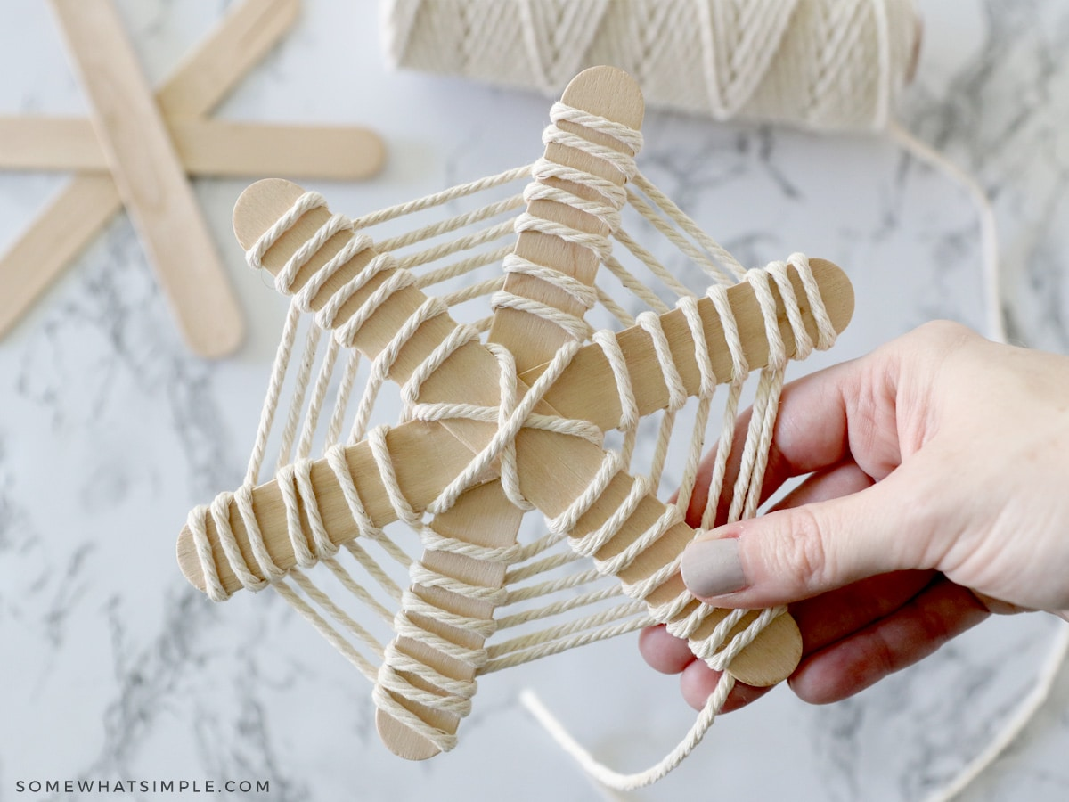wrapping popsicle sticks in yard