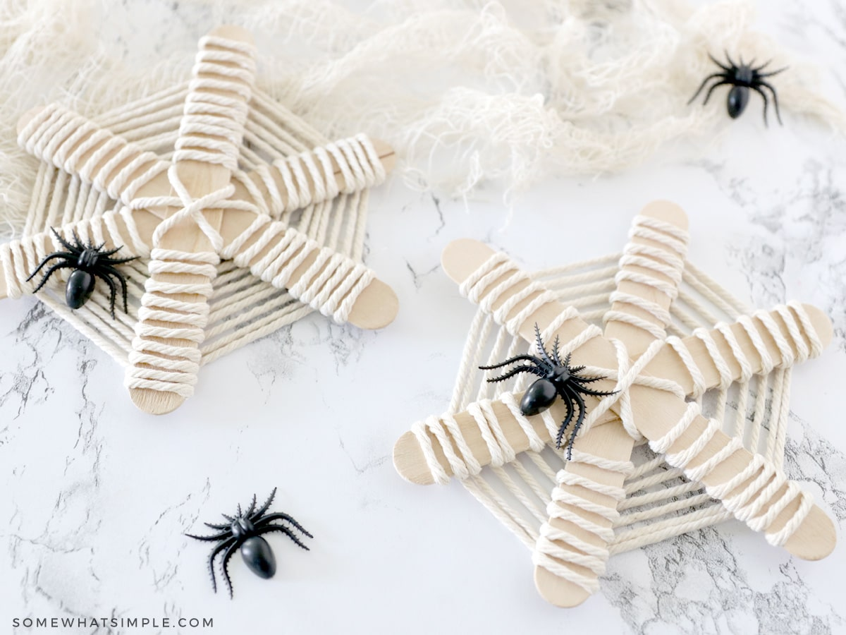 spider webs made from popsicle sticks